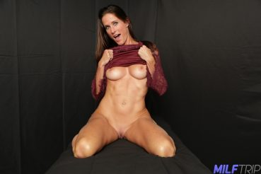 Slender MILF shows tits while being filmed