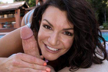 Brunette bombshell Becky Bandini works over a huge dick stud