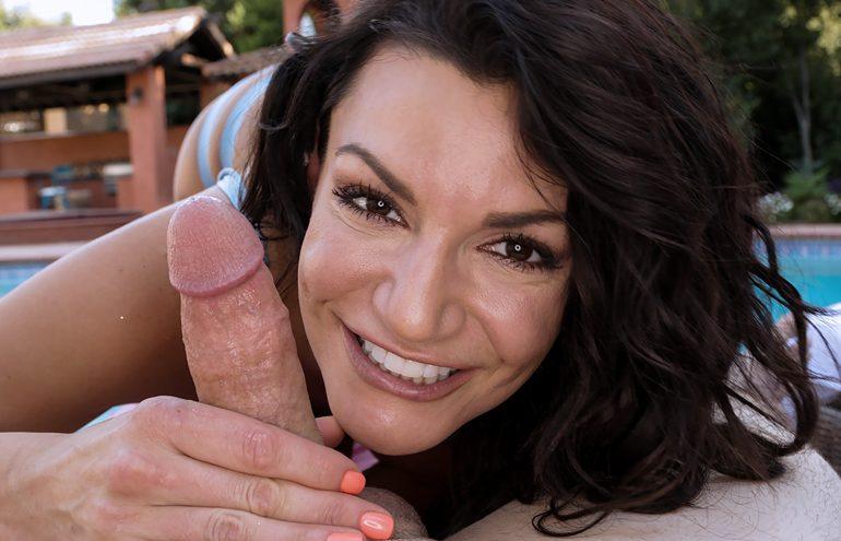 Brunette bombshell Becky Bandini works over a huge dick stud